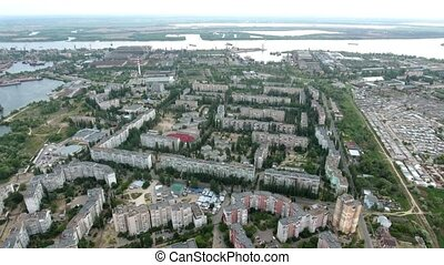 Aerial shot of a curvy coastline of the Dnipro river and Kherson quay in summer