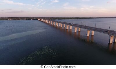 Aerial shot of a far-off bridge over the Dnipro from a drone...