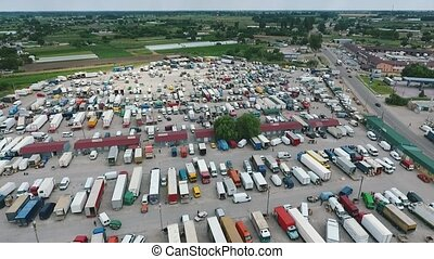 Aerial shot of a farmers` market with rows of trucks and trailers in autumn
