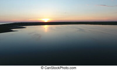 Aerial shot of a fine sunset over a  small island in the Black Sea in summer