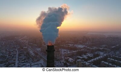 Aerial shot of a giant industrial tower with thick smoke at...