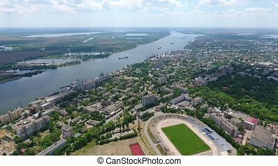 Aerial shot of a green city area on the Dnipro river bank in summer