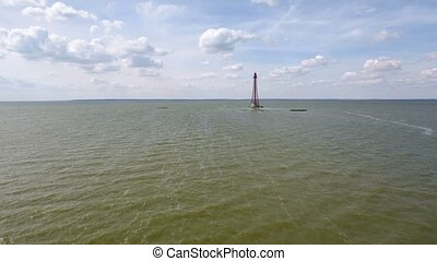 Aerial shot of a high lighthouse not far from Dzharylhach island in Ukraine