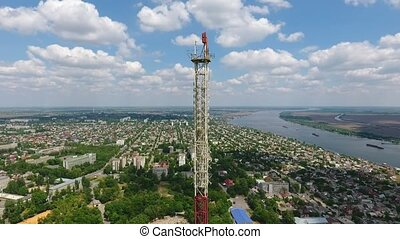 Aerial shot of a high metallic TV tower and the Dnipro river...