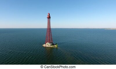 Aerial shot of a high red beacon on the Black Sea shoal in...