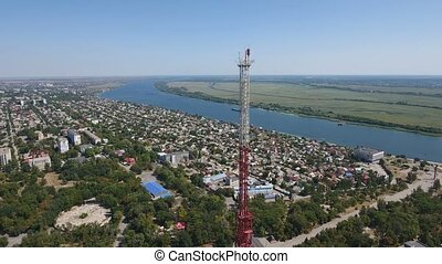 Aerial shot of a high TV tower on the Dnipro bank with...