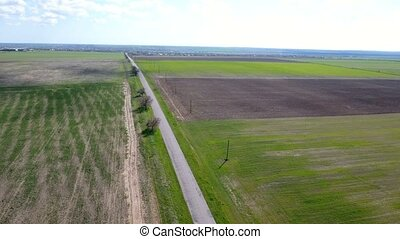 Aerial shot of a highway and a road stretching along some...