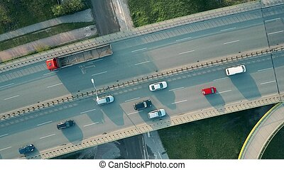 Aerial shot of a highway in the evening, top down view
