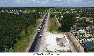Aerial shot of a highway reparing with one black lane done...