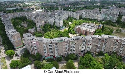 Aerial shot of a huge and curvy multistoreyed block in...