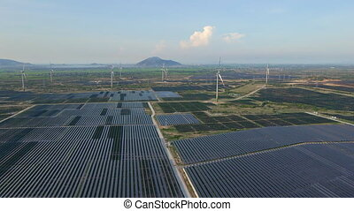Aerial shot of a huge solar power plant mixed with wind ...