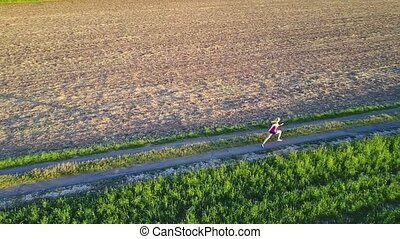 aerial shot of a jogger in slow motion