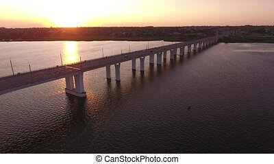 Aerial shot of a lengthy bridge covering the Dnipro at...