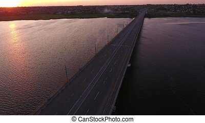 Aerial shot of a lofty bridge over the Dnipro at a violet...