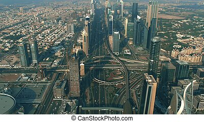 Aerial shot of a major city highway interchange traffic. Dubai, UAE