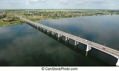 Aerial shot of a modern car bridge in Kherson in a sunny day...