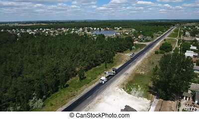 Aerial shot of a modern motorway reparing with one black...