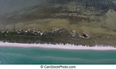 Aerial shot of a mysterious thin island on the Blach Sea coast in summer