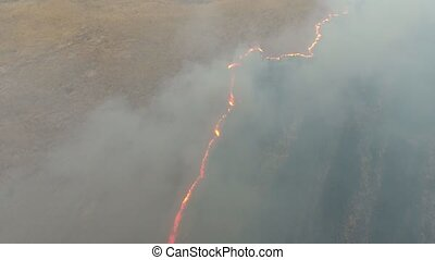 Aerial shot of a natural fire and smoke disaster in the...