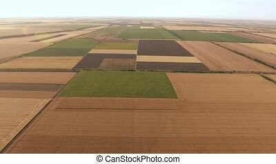Aerial shot of a neo-geo looking field on a sunny day in...