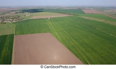 Aerial shot of a picturesque countryside fields in Estern Europe in spring