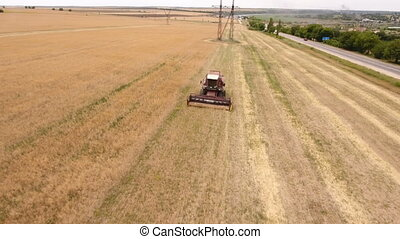 Aerial shot of a picturesque ripe field and a combine...