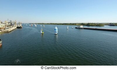 Aerial shot of a reagatta yachts sailing in the picturesque Dnipro in summer