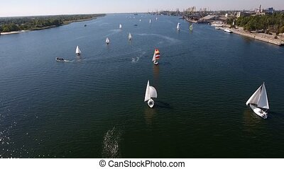 Aerial shot of a regatta with a lot of yachts sailing in the...