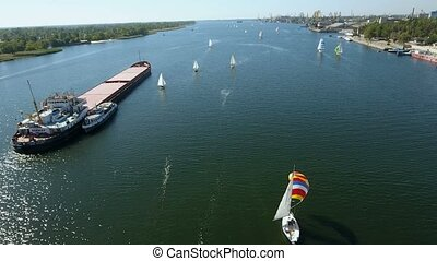 Aerial shot of a regatta with a many yachts sailing in the Dnipro in summer