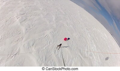 Aerial shot of a skiing man