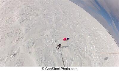 Aerial shot of a skiing man