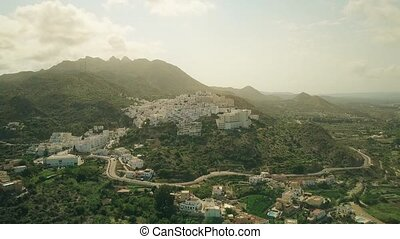 Aerial shot of a small town in Andalusian mountains, Spain -...