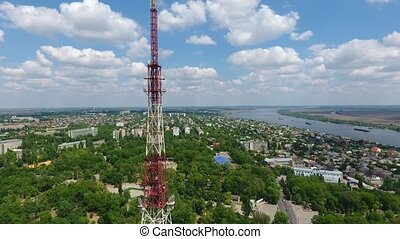 Aerial shot of a spiky TV tower and the boundless Dnipro in...