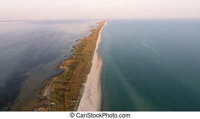 Aerial shot of a straight and narrow Dzharylhach island sand...