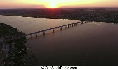 Aerial shot of a stringy bridge over the Dnipro at surreal...