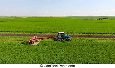 Aerial Shot Of A Tractor In The Field