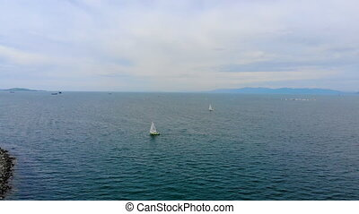 Aerial shot of a two sailing yachts boats on a race