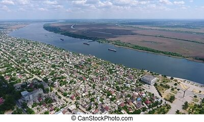 Aerial shot of a Ukrainian city on the Dnipro river bank on...