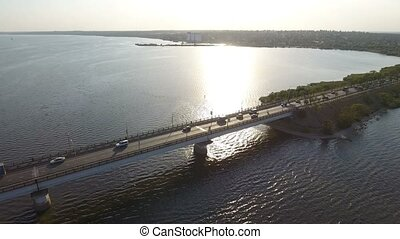Aerial shot of a unique bridge over the Southern Bug at sunset in summer
