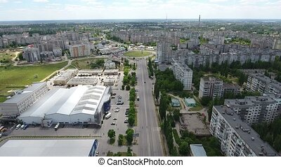 Aerial shot of a wide highway in Kherson city in a sunny day...