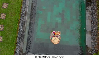 Aerial shot of a young woman tourist has her own personal...