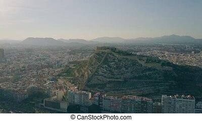 Aerial shot of Alicante cityscape and Santa Barbara castle