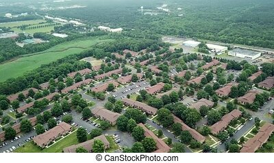 Aerial shot of American rooftops of residential and other buildings in the river US