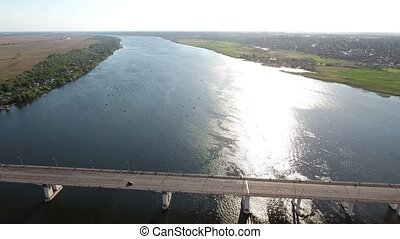 Aerial shot of an automobile bridge over the Dnipro river in  summer