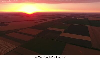 Aerial shot of an icredible golden sunset over a striped...