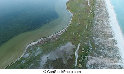 Aerial shot of an island with a long sandy coast and wetland in the Black Sea