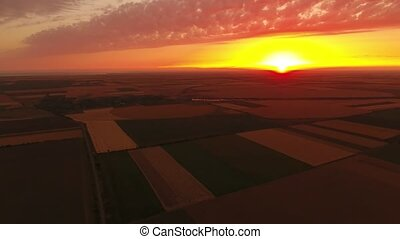 Aerial shot of an orange and yellow sunset over a...