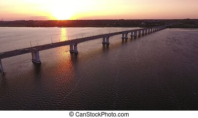 Aerial shot of an outstretched bridge over the Dnipro at a...