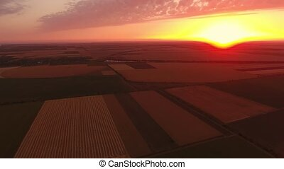 Aerial shot of an unforgettable golden sunset over a striped...