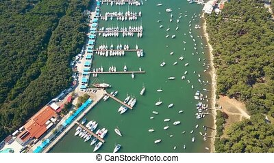 Aerial shot of anchored boats, motorboats and sailboats at...